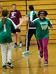 TORRINGTON, CT- 6 November 2014-110614EC01--   Kayla Correia slaps hands with Allison Cruz after Correia made a goal Thursday night. Torrington High School hosted the Unified indoor soccer tournament. The unified teams combined Special Olympics athletes and varsity students. Erin Covey Republican-American