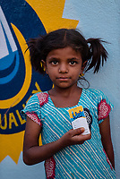 A young girl poses with the iJal card at the iJal water station in Ambedkar Nagar in Medak, Telangana, India.