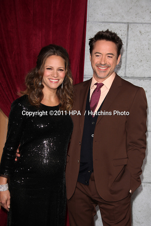 "LOS ANGELES - DEC 6:  Robert Downey Jr and wife Susan Downey arrives at the ""Sherlock Holmes: A Game of Shadows"" Los Angeles Premiere at Regency Village Theatre on December 6, 2011 in Westwood, CA"