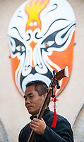 A musician plucks away during a performance in the Sanmenxia pit yards.
