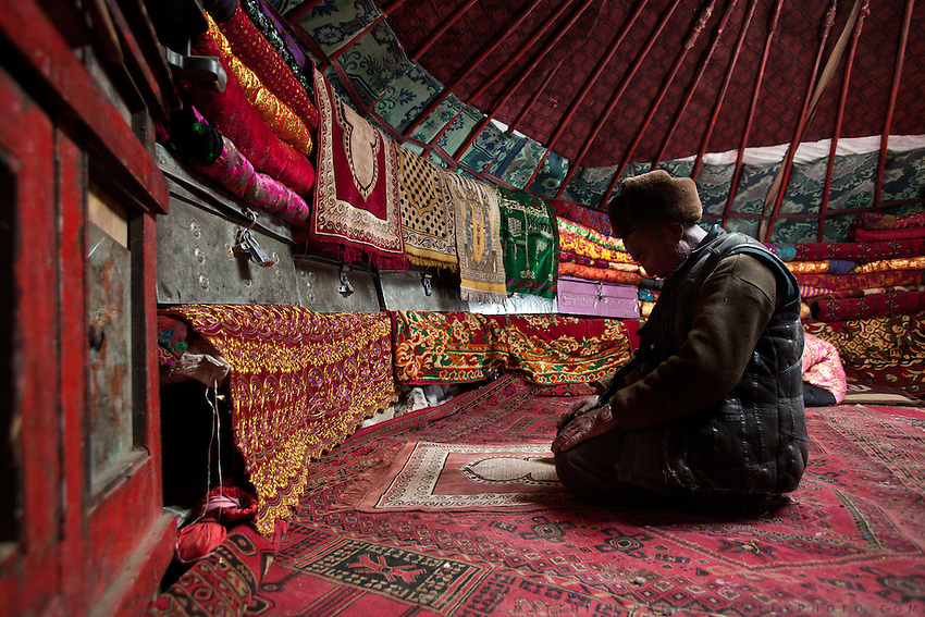 Abdul Rahman praying in his yurt. There are no Mosques in the Pamir. Afghan Kyrgyz are Sunni Muslims...Summer camp of Muqur, Er Ali Boi's place...Trekking through the high altitude plateau of the Little Pamir mountains (average 4200 meters) , where the Afghan Kyrgyz community live all year, on the borders of China, Tajikistan and Pakistan.