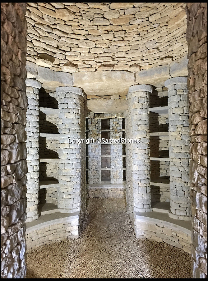 BNPS.co.uk (01202 558833)<br /> Pic: SacredStones/BNPS<br /> <br /> The earth covered barrow contains 400 niches for families to reserve at £2000 to £5000 a plot.<br /> <br /> Building boom after 4000 years - Neolithic barrows are being built again as burial mounds for modern Britons.<br /> <br /> Prehistoric tombs used to store the ashes of loved ones are being built on UK soil for the first time in thousands of years. <br /> <br /> Until now Neolithic earth mounds built over the dead, known as long barrows, had not been used since around 2,000 BC. <br /> <br /> The limestone frame covered in soil and grass was entirely handmade by a team of four stonemasons using traditional techniques over the course of five months. <br /> <br /> The firm will be selling 400 plots, or niches, near Hail Weston, Cambs, for between £1,950 and £4,800.