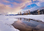 Yellowstone National Park, Wyoming/Montana: Colorful clouds reflected in the Lamar River at sunrise in the Lamar Valley