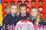 Ria O'Connor-Coffey, Doireann Dwyer and Rebecca O'Leary getting their bags ready to go home after their first day at school in Anabala NS, Kilcummin on Friday ..