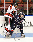 Julia Marty (NU - 16), Kelly Horan (UConn - 21) - The visiting University of Connecticut Huskies defeated the Northeastern University Huskies 4-2 (EN) in NU's senior game on Saturday, February 19, 2011, at Matthews Arena in Boston, Massachusetts.