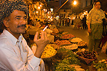 A fruit vendor in the old bazaar in Rawalpindi in Pakistan