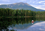 Woman in a red canoe on Upper Togue Pond, Baxter State Park, Maine, USA