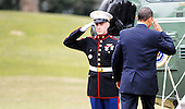 United States President Barack Obama salutes the Marine Guard as he boards Marine 1 to depart the White House en route to Savannah, Georgia, Tuesday,  March 2, 2010 in Washington DC..Credit: Olivier Douliery / Pool via CNP