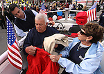 Republican gubernatorial candidate Brian Sandoval talks with his parents Ron and Marion Sandoval while waiting their turn to walk in the Nevada Day parade on Saturday, Oct. 30, 2010, in Carson City, Nev. .Photo by Cathleen Allison