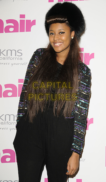 VV BROWN aka Vanessa Brown.The Hair Magazine Awards, Grosvenor Place, London, England. .September 29th, 2009 .half length black harem trousers sequins sequined jacket top blue fur furry hat hand in pocket.CAP/CAN.©Can Nguyen/Capital Pictures.