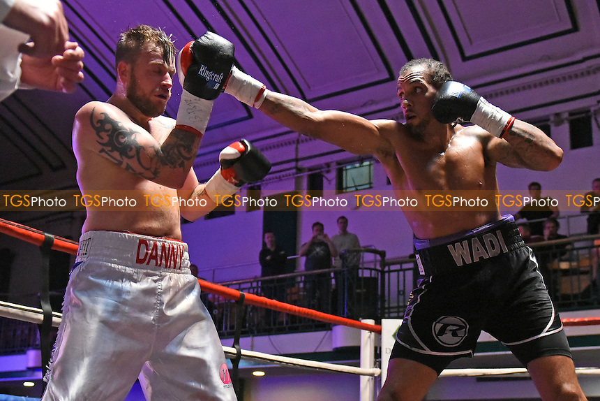 Wadi Camacho (black shorts) defeats Danny Couzens to win the Southern Area Cruiserweight Title during a Boxing Show at York Hall on 16th July 2016