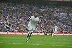 Swansea forward Scott Sinclair celebrates as he completes his hat-trick from the penalty spot during the Npower Championship play-off final between Reading (blue) and Swansea City at Wembley Stadium. The match was won by Swansea by 4 goals to 2 watched by a crowd of 86,581. Swansea became the first Welsh team to reach the top division of English football since they themselves played there in 1983.