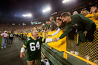 Former Green Bay Packer guard Jerry Kramer greets fans as he leaves the field after the alumni introductions prior to the game against the Seattle Seahawks on Sept. 20, 2015.