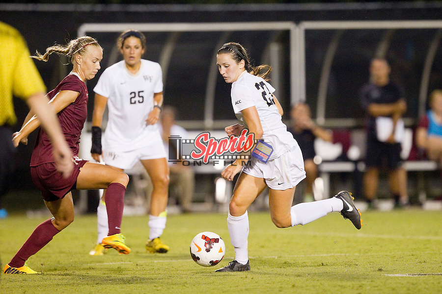 Kendall Fischlein (23) of the Wake Forest Demon Deacons controls the ball against the Florida State Seminoles at Spry Soccer Stadium on September 12, 2013 in Winston-Salem, North Carolina.  The Deacons and the Seminoles played to a 0-0 draw.   (Brian Westerholt/Sports On Film)