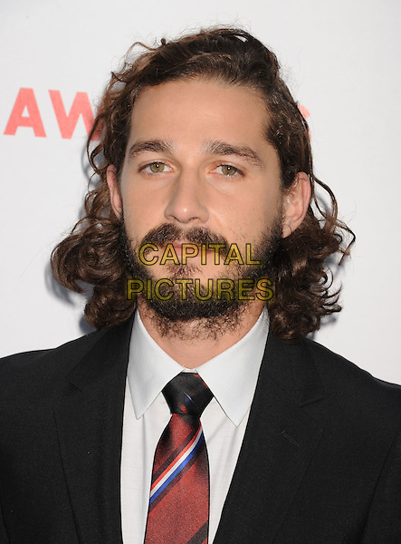 "Shia LaBeouf.""Lawless"" premiere held at ArcLight Cinemas, Hollywood, California, USA..August 22nd, 2012.headshot portrait black suit white shirt tie beard facial hair red .CAP/ROT/TM.©Tony Michaels/Roth Stock/Capital Pictures"