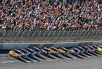 Apr 26, 2009; Talladega, AL, USA; NASCAR Sprint Cup Series driver Kyle Busch (18) leads the field during the Aarons 499 at Talladega Superspeedway. Mandatory Credit: Mark J. Rebilas-