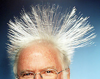HERALD STAFF PHOTO BY NIKI DESAUTELS.DATE TAKEN: 062306..Dr. Science, aka Chuck Newcombe, shows off the length of his hair with help from the Van de Graaf machine, which creates static electricty.  ..--TEASER--