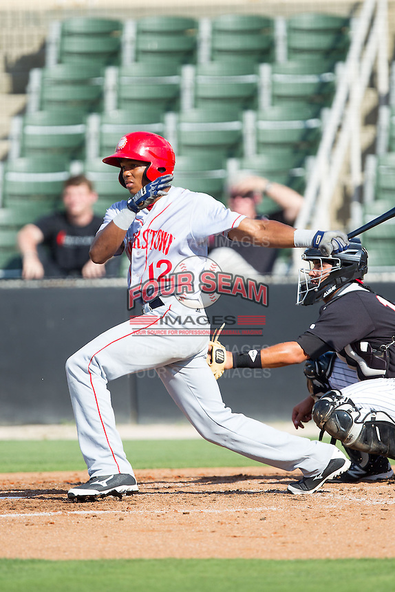 Rafael Bautista (12) of the Hagerstown Suns follows through on his swing against the Kannapolis Intimidators at CMC-Northeast Stadium on May 31, 2014 in Kannapolis, North Carolina.  The Intimidators defeated the Suns 3-2 in game one of a double-header.  (Brian Westerholt/Four Seam Images)