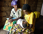Community Health Worker Marie Chantal monitors a mom nursing her three-week old newborn in Batamuliza Hururiro village, near Rukumo Health Center, Rwanda