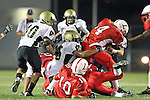 Lawndale, CA 10/01/10 - Carlos Banuelos (Lawndale #10), Kaelyn Henderson (C)  (Lawndale #4), Jin Matsumoto (Peninsula #40) and Sammy Brown (Peninsula #35) in action during the Peninsula-Lawndale Varsity football game.