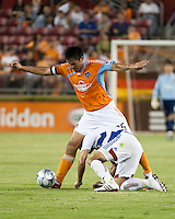 Houston Dynamo forward Brian Ching (25) and FC Dallas midfielder Marcelo Saragosa (5) collide.  Houston Dynamo defeated FC Dallas 1-0 at Robertson Stadium in Houston, TX on May 9, 2009