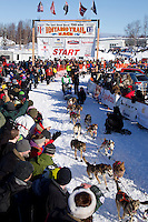 Sunday, March 4, 2012  Colleen Robertia and her dog team depart the starting line and enter the starting chute at the restart of Iditarod 2012 in Willow, Alaska. Huge crowds of spectators lined the chute to catch a glimpse of the race.