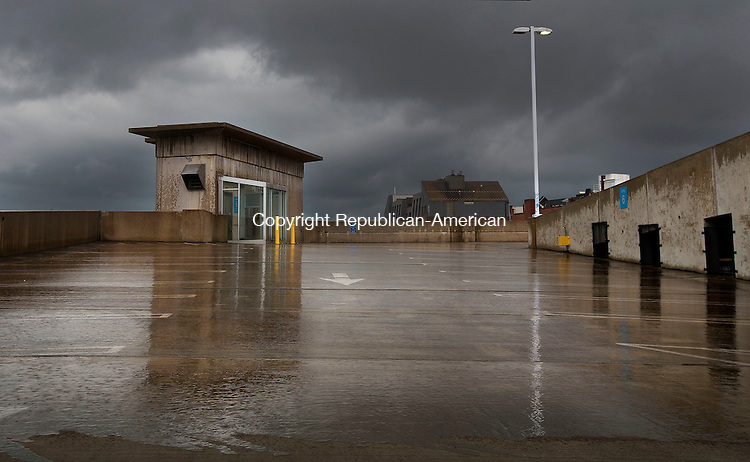 Waterbury, CT- 31 May 2015-053115CM12- Rain falls on top a parking garage at the Palace Theater in Waterbury  on Sunday.  According to the National Weather Service, Monday is expected to bring showers and possibly a thunderstorm with a high near 55 degrees.  Christopher Massa Republican-American