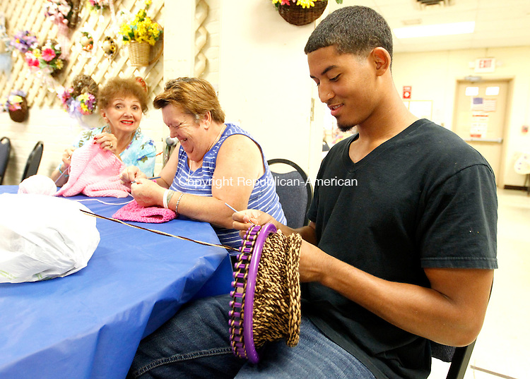"Naugatuck, CT- 22 July 2013-072213CM05- Margo Scott, far left, June Ottowell, center, of Naugatuck share a laugh with Richard Brito, 17,  of Naugatuck and a Kaynor Tech High School student at the Naugatuck Senior Center on Monday. Scott and Ottowell were knitting newborn baby blankets, which will be donated to an area hospital, Brito was weaving a winter hat.  Brito learned how to weave and crochet from the women at the senior center, which was part of the New Opportunities Inc. of Waterbury  Summer Youth Program.  ""It's very calming."" Brito said. ""I never thought I'd be doing this.""  He added the experience at the Senior Center has taught him patience and helped him deal with the public.  Brito calls bingo, gardens, answer phones, works with the public, serves lunch and has host of other duties said Director Harvey Leon Frydman.  The Senior Center has been working with New Opportunities for 6 years and has provided students with jobs for 6 weeks during the center.  ""We help them find their first job."" said Frydman.    ""Our seniors are willing to share their time, their expertise, their wisdom and their skills.""  said Harvey. At the end of the summer, Frydman said the center will make a resume for Brito and serve as a reference for him.    Christopher Massa Republican-American"