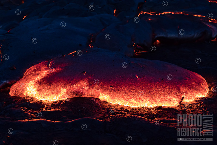 A lava toe glows on the Kilauea coastal plains in Pulama Pali, Puna district, Hawai'i Island, early New Year's Day 2018.
