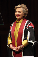 Pictured: Hillary Clinton on stage while being award her honorary degree at Swansea University Bay Campus. Saturday 14 October 2017<br /> Re: Hillary Clinton, the former US secretary of state and 2016 American presidential candidate will be presented with an honorary doctorate during a ceremony at Swansea University's Bay Campus in Wales, UK, to recognise her commitment to promoting the rights of families and children around the world.<br /> Mrs Clinton's great grandparents were from south Wales.