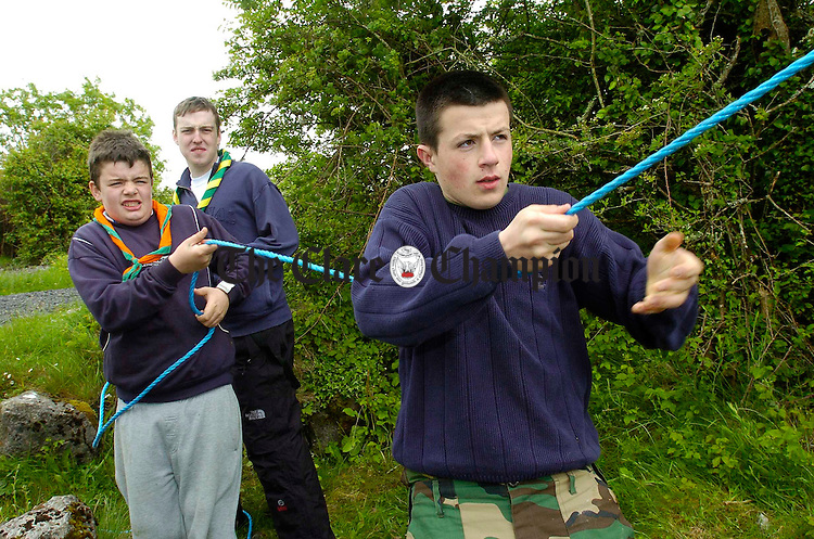 Dylan Ryan and Seamus Mc Mahon of Clarecastle third Clare troop in action, under the watchful eye of Shannon leader Sean Bennett during the Scout Camp All-Ireland Shield. Photograph by John Kelly.