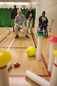 Long skittles game at the Monday Night Club, a sports session at Talacre Sports Centre, Camden, for adults with physical or learning disabilities.