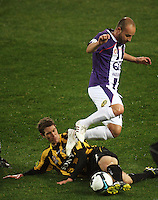 Phoenix' Tony Lochhead tackles Perth's Adriano Pellegrino during the A-League football match between Wellington Phoenix and Perth Glory at Westpac Stadium, Wellington, New Zealand on Sunday, 16 August 2009. Photo: Dave Lintott / lintottphoto.co.nz