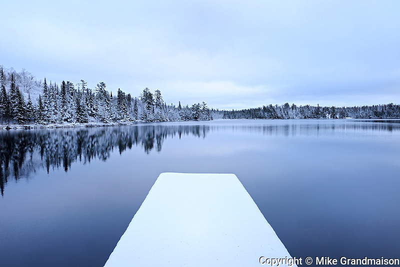 Snow on dock in Lyons Lake in early winter<br /> Whiteshell Provincial Park<br /> Manitoba<br /> Canada
