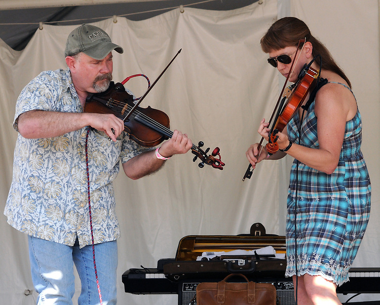 Darren Wallace and Missy Roser of Jesse Lege & Bayou Brew performing on the Main Stage at the Falcon Ridge Folk Festival, held on Dodd's Farm in Hillsdale, NY on Saturday, August 1, 2015. Photo by Jim Peppler. Copyright Jim Peppler 2015.