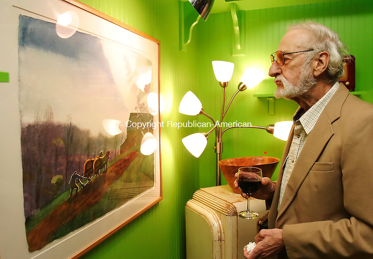 WOODBURY,  CT 25 September 2005 -092505BZ10-  Tony Fattibene, of Woodbury, looks at a painting during a reception at the Good News Cafe featuring artwork that will be available during the Four Seasons of Flanders benefit Auction and Dinner to be held in October. Fattibene said his wife, artist Melody Asbury, also had work on display at the Cafe.<br /> Jamison C. Bazinet / Republican-American