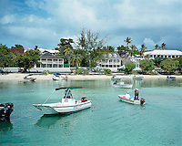 Pleasure boats dot the calm waters along the shoreline infront of the hotel