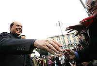 Il leader del Popolo della Liberta' Silvio Berlusconi arriva in Piazza del Popolo, Roma, 12 marzo 2008, per presentare presenta il Camper della Liberta'..Leader of the People of Freedom's center-right coalition Silvio Berlusconi, left, shakes hands to sympathizers as he arrives in Rome's Piazza del Popolo, 12 march 2008 to present the Camper of Freedom..UPDATE IMAGES PRESS/Riccardo De Luca