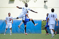 2 October 2011:  FIU defender Jahbari Willis (7) attempts to head the ball in the second half as the FIU Golden Panthers defeated the University of Kentucky Wildcats, 1-0 in overtime, at University Park Stadium in Miami, Florida.