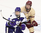 Cameron Lawson (HC - 10), Michael Matheson (BC - 5) - The visiting College of the Holy Cross Crusaders defeated the Boston College Eagles 5-4 on Friday, November 29, 2013, at Kelley Rink in Conte Forum in Chestnut Hill, Massachusetts.