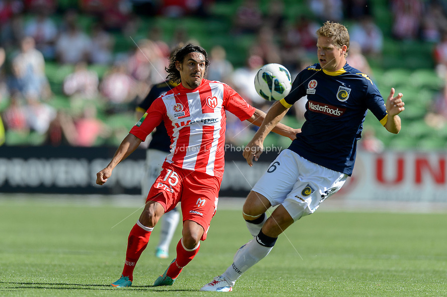 MELBOURNE - OCT 28: David WILLIAMS of the Heart and Patrick ZWAANSWIJK of the Mariners fight for the ball kicks the ball in the round four A-League match between the Melbourne Heart and the Central Coast Mariners at AAMI Park. (Photo Sydney Low/syd-low.com/Melbourne Heart)