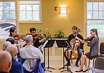 WOODBURY, CT. 06 May 2018-050618BS09 - From left, Violinist Yaira Matyakubova, Violinist Gregory Tompkins, Cellolist Philip Boulanger, and playing the Viola Annalisa Boerner, better known as The Haven String Quartet play a concert at the Woodbury Senior/Community Center on Sunday afternoon. Bill Shettle Republican-American