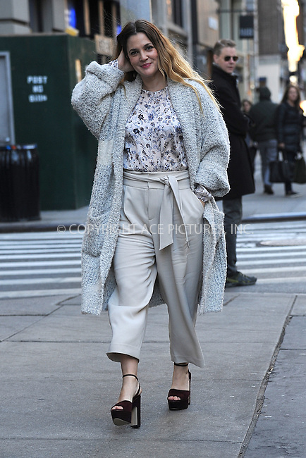 WWW.ACEPIXS.COM<br /> December 16, 2015 New York City<br /> <br /> Drew Barrymore arrives to Club Monaco for a book signing for 'Wildflower' in New York City on December 16, 2015.<br /> <br /> Credit: Kristin Callahan/ACE Pictures<br /> <br /> tel: 646 769 0430<br /> Email: info@acepixs.com<br /> www.acepixs.com