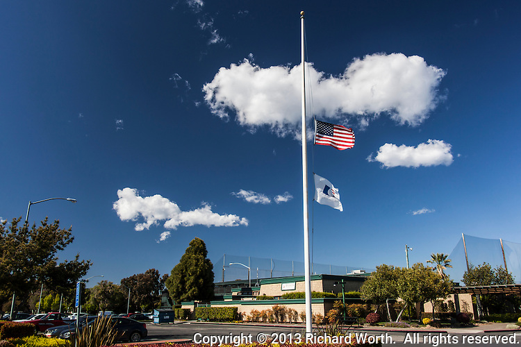 The American flag and American Golf Flag fly at half mast outside of the Tony Lema Golf Course, a municipal course in San Leandro, California, over 3,000 miles away from Boston, Massachusetts, and the Boston Marathon bombing.