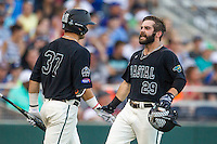 Coastal Carolina Chanticleers outfielder Anthony Marks (29) celebrates with teammate G.K. Young (37) after scoring a run against the Florida Gators in Game 4 of the NCAA College World Series on June 19, 2016 at TD Ameritrade Park in Omaha, Nebraska. Coastal Carolina defeated Florida 2-1. (Andrew Woolley/Four Seam Images)