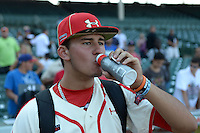 Pitcher Joe Gatto (33) of St. Augustine Prep in Hammonton, New Jersey drinks some Gatorade after the Under Armour All-American Game on August 24, 2013 at Wrigley Field in Chicago, Illinois.  (Mike Janes/Four Seam Images)