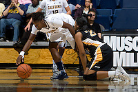 Afure Jemerigbe of California steals the ball away from Raven Benton of Long Beach State during the game at Haas Pavilion in Berkeley, California on November 8th, 2013.  California defeated Long Beach State, 70-51.