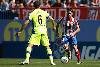 01.04.2012 MADRID, SPAIN -  La Liga match played between At. Madrid vs Getafe (3-0) at Vicente Calderon stadium. the picture show Mehdi Gregory (Midfielder of Getafe) and  Diego Ribas da Cunha (Brazilian midfielder of At. Madrid)
