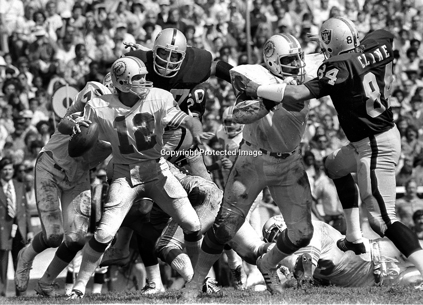 Oakland Raiders put pressure on Miami Dolphins QB Bob Grease, Bubba Smith and Tony Cline...(1973 photo/Ron Riesterer)