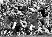 Oakland Raiders put pressure on Miami Dolphins QB Bob Grease, Bubba Smith and Tony Cline...(1973 photo/Ron Riesterer)